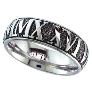 Dome profile Titanium ring with external engraved inverted Roman Numeral date of your choice.