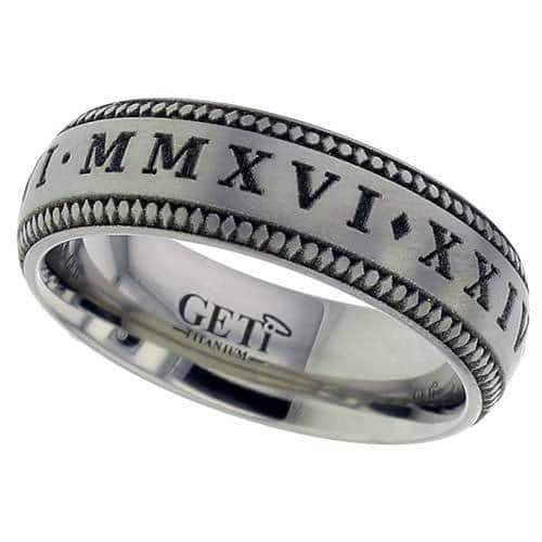 Dome profile Titanium ring with laser engraved Roman Numerals and vintage pattern edges.