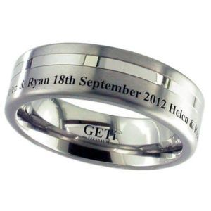 Flat profile Titanium ring with two off centre grooves and outside edge engraving.